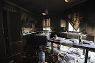 <p>A picture shows damage inside the burnt US consulate building in Benghazi on September 13, following an attack on the building late on September 11. Libya announced Sunday the arrest of 50 suspects over the killing of the US envoy and three other Americans, blaming the Benghazi attack on foreign extremists and claiming it was pre-planned.</p>