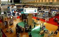 This file photo shows visitors passing by the stand of Saudi Arabia's national oil company Aramco at the Abu Dhabi International Petroleum Exhibition, in 2008. The US believes Iran was behind a major cyberattack on Aramco and a Qatari gas firm, a former US official who has worked on cybersecurity issues said on Friday