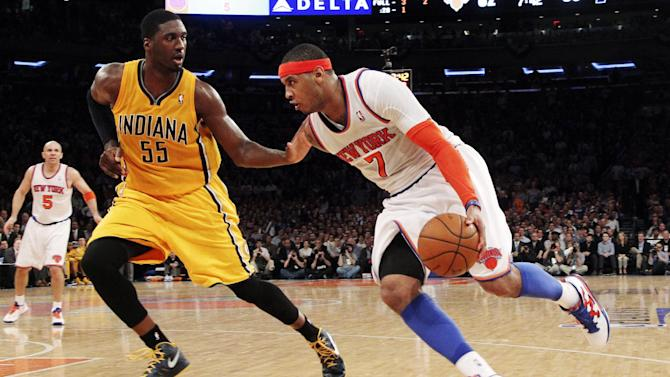 New York Knicks' Carmelo Anthony (7) drives past Indiana Pacers' Roy Hibbert (55) in the second half of Game 2 of their NBA basketball playoff series in the Eastern Conference semifinals at Madison Square Garden in New York, Tuesday, May 7, 2013. The Knicks won 105-79. (AP Photo/Mary Altaffer)