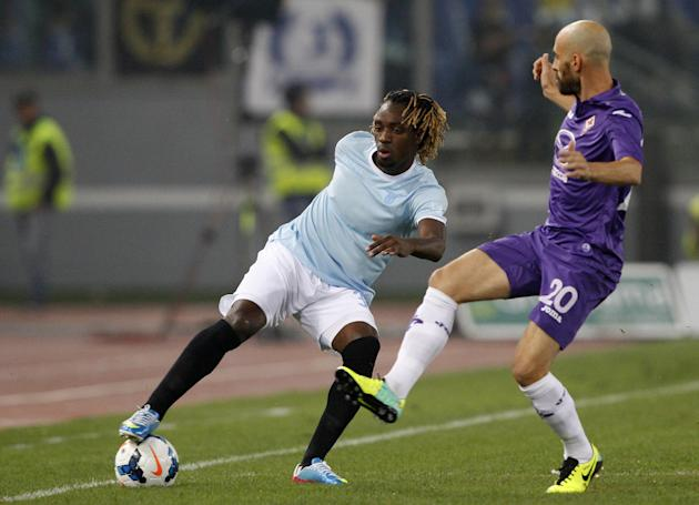 Lazio defender Luis Pedro Cavanda, of Angola, left,  is challenged by Fiorentina midfielder Borja Valero, of Spain, right, during a Serie A soccer match between Lazio and Fiorentina, at Rome's Olympic
