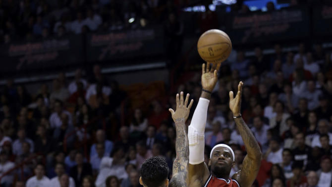 Miami Heat's LeBron James (6) shoots over Los Angeles Clippers' Matt Barnes (22) during the first half of an NBA basketball game in Miami, Friday, Feb. 8, 2013. (AP Photo/Alan Diaz)