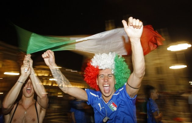 Italian supporters celebrates after their team won the match against Germany during the Euro 2012 semi-final, in Milan