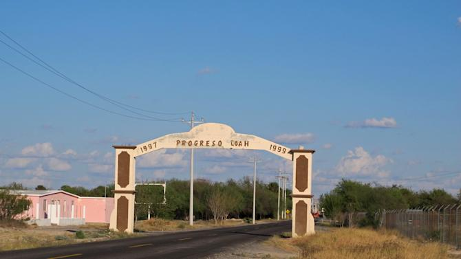 This Oct. 10, 2012 photo shows an entrance to the town of Progreso, the alleged site where Heriberto Lazcano, a founder and top leader of the Zetas drug cartel, was killed in Mexico's Coahuila state. Despite the crowd, nobody is willing to admit they were there the afternoon of Oct. 7 or saw the shootout just outside the ball field in the heart of Coahuila state, the alleged site where Mexican marines  gunned down Lazcano,  the biggest kingpin netted so far in Mexico's President Felipe Calderon's six-year assault on organized crime. (AP Photo/Olga R. Rodriguez)