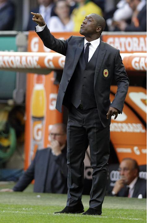 AC Milan coach Clarence Seedorf, of the Netherlands, gives indications to his players during a Serie A soccer match between AC Milan and Parma, at the San Siro stadium in Milan, Italy, Sunday, March 1