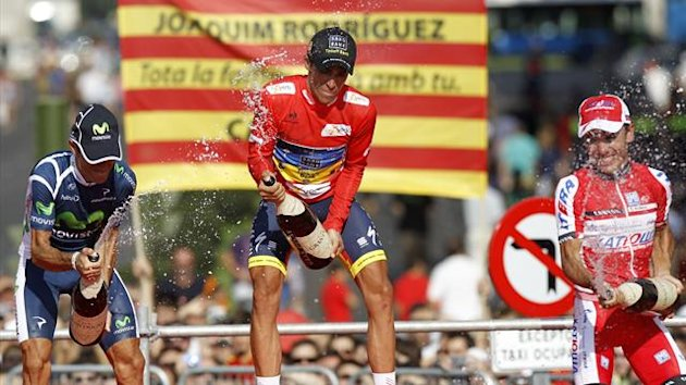 Team Saxo Bank rider Alberto Contador (C) of Spain celebrates on the podium after winning the Tour of Spain next to second-placed Movistar Team's Alejandro Valverde (L) of Spain and third-placed Katusha Team rider Joaquim Rodriguez of Spain (Reuters)