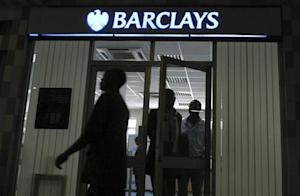 People walk out of a Barclays bank branch inside Barclays Plaza in Nairobi