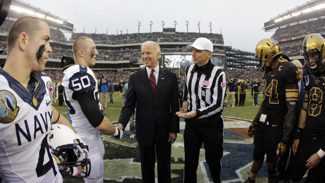 Vice President Joe Biden, center, greets Navy's Brye French before the coin toss before an NCAA college football game against Army, Saturday, Dec. 8, 2012, in Philadelphia. (AP Photo/Matt Slocum)