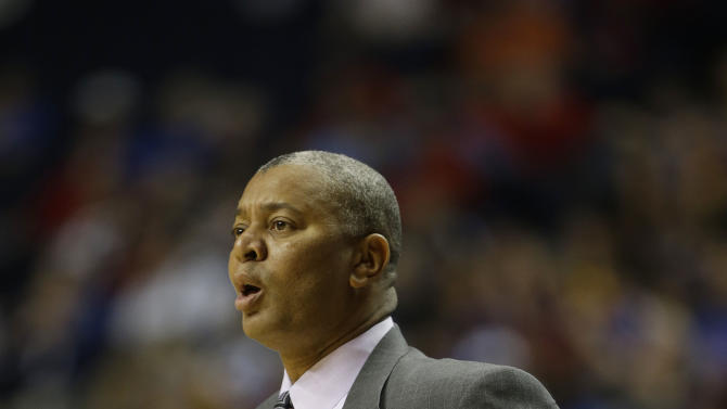 LSU head coach Johnny Jones watches play against the Florida during the first half of an NCAA college basketball game at the Southeastern Conference tournament, Friday, March 15, 2013, in Nashville, Tenn. (AP Photo/Dave Martin)