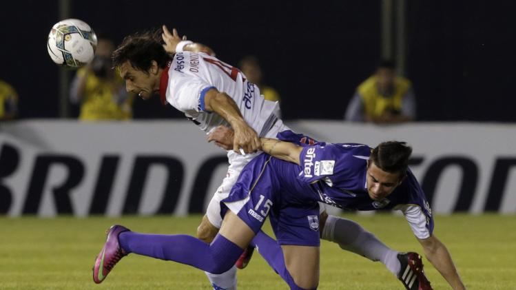 Pais of Defensor Sporting challenges Mendoza of Nacional during their Copa Libertadores semi-final soccer match in Asuncion