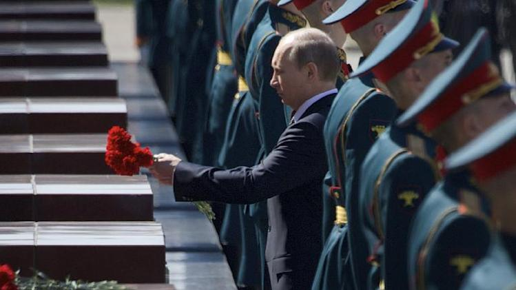 Russian President Vladimir Putin attends a wreath laying ceremony at the Tomb of Unknown Soldier on the eve of Victory Day celebration in Moscow, Russia, Wednesday, May 8, 2013. Russia's marking the surrender of Nazi Germany in World War II on May 9th. (AP Photo/Ivan Sekretarev)
