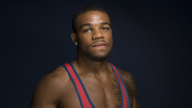 FILE - In this May 15, 2012 file photo, freestyle wrestler Jordan Burroughs poses for a photo at the 2012 Team USA Media Summit in Dallas. His performance at the London Games cemented his status as perhaps the best athlete in the world in his sport _ a sport that just a few months later in fighting for its very existence. (AP Photo/Victoria Will, File)