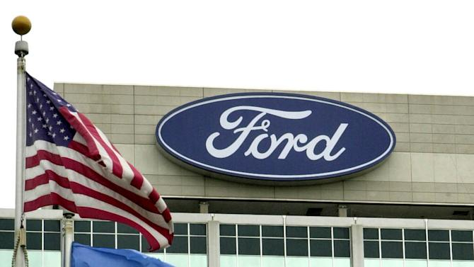 FILE - Ford Motor Company's logo is shown  atop its world headquarters in Dearborn, Mich., in this June 5, 2003 file photo. Ford's net income fell from $13.6 billion in the same quarter last year, but that figure included a big accounting-related gain it was announced Tuesday Jan. 29, 2013. Without that gain, Ford's earnings were up from $1 billion in the fourth quarter of last year. (AP Photo/Paul Sancya)