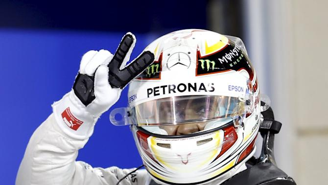 Mercedes Formula One Driver Hamilton of Britain celebrates taking the pole position ahead of Bahrain's F1 Grand Prix at Bahrain International Circuit, south of Manama