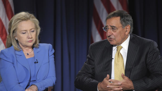 Secretary of State Hillary Rodham Clinton listens as Defense Secretary Leon Panetta speaks during an event at the National Defense University in Washington, Tuesday, Aug. 16, 2011. (AP Photo/Susan Walsh)