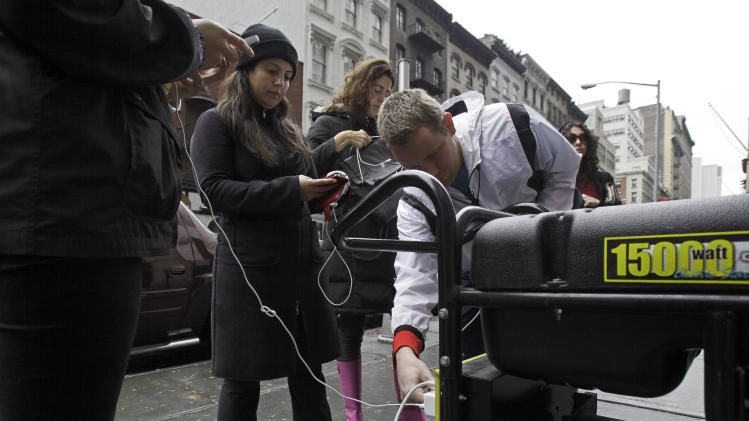 New Yorkers search for food, water and electricity