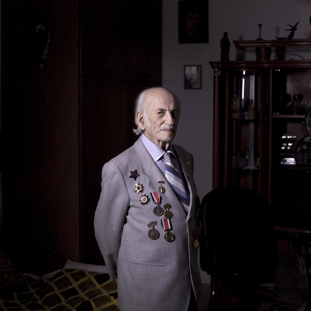 In this photo made Friday, April 12, 2013, Soviet Jewish World War Two veteran Semion Tzvang 89, poses for a portrait at his house in the southern Israeli city of Ashkelon. Tzvang joined the Red Army