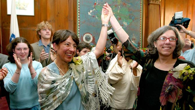 FILE - Maureen Brodoff, right, and Ellen Wade, react to the cheers of family and friends after the completion of their marriage ceremony at City Hall in Newton, Mass., in this May 17, 2004 file photo. Massachusetts, in 2004, became the first state to permit gay marriage. More followed suit. (AP Photo/Jim Rogash, File)
