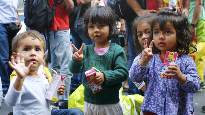 Migrants' children gesture near the Keleti railway station in Budapest