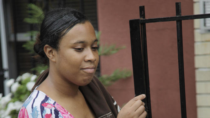 Olgita Blackwood, left, looks at her daughter, Malaysia Blackwood, 7, while waiting for her son to return from school at their apartment in the Drew House in New York, Wednesday, Oct. 3, 2012.  The program, called Drew House, is one of a kind in the nation, where mothers arrested on felonies can live with their children, instead of in prison. The program has been lauded as a success that should be replicated around the country, but the small house is already full, and without additional funding and space, it can't grow. (AP Photo/Seth Wenig)