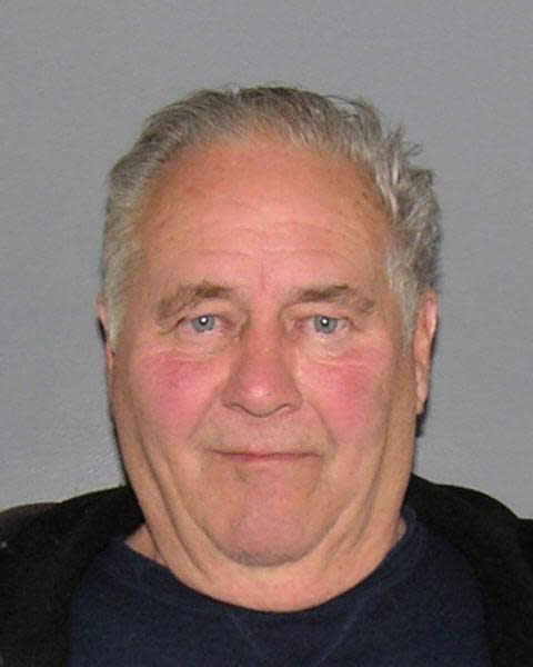 This official police mugshot provided by the Hamilton County Sheriff's office shows 74-year-old Robert Marx. Marx was arrested on charges of knowingly shooting a gun within city limits and criminal damaging in the fatal shooting of a 1-year-old pitbull named Bruski at a Cincinnati dog park on Tuesday. (AP Photo/Hamilton County Sheriff)