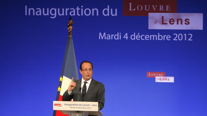France's President Francois Hollande deliveers a speech during the inauguration of the Louvre Museum in Lens, northern France, Tuesday, Dec. 4, 2012. The museum in Lens is to open on Dec. 12, as part of a strategy to spread art beyond the traditional bastions of culture in Paris to new audiences in the provinces. (AP Photo/Michel Spingler, Pool)