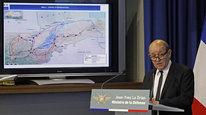 French defense minister Jean Yves Le Drian addresses reporters during a press conference held at the defense ministry in Paris, Tuesday Jan. 15, 2013. Map at left shows the operations zone in Mali. France carried out new airstrikes overnight against Islamist fighters in central Mali.(AP Photo/Remy de la Mauviniere)