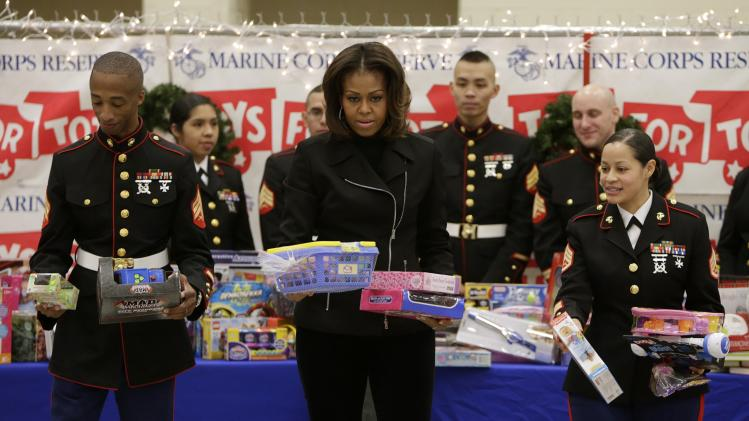 US First Lady Michelle Obama helps sort children's gifts in Toys for Tots holiday campaign in Washington