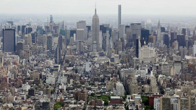 FILE- In this May 20, 2015 file photo, Midtown Manhattan, including the Empire State Building, center, are seen from the observatory at One World Trade Center in New York. Renters are on the rise in America's biggest cities, but many tenants are scrambling to keep up with growing rent bills and shrinking vacancies, according to a study being released Thursday, May 28, 2015. (AP Photo/Mark Lennihan, File)