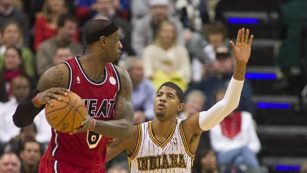 Indiana Pacers' Paul George (24) defends against Miami Heat's LeBron James (6) who brings the ball upcourt during the second half of an NBA basketball game in Indianapolis, Friday, Feb. 1, 2013. The Pacers defeated the Heat 102-89. (AP Photo/Doug McSchooler)