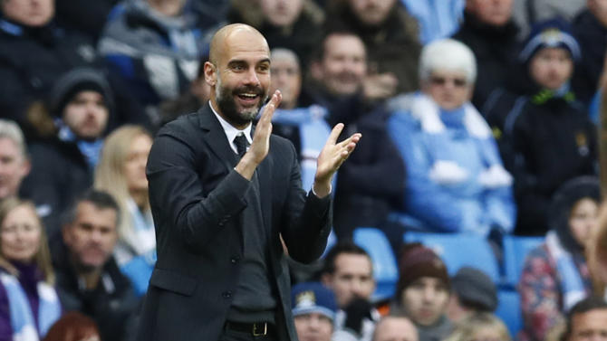 Manchester City manager Pep Guardiola celebrates referee Anthony Taylor's decision