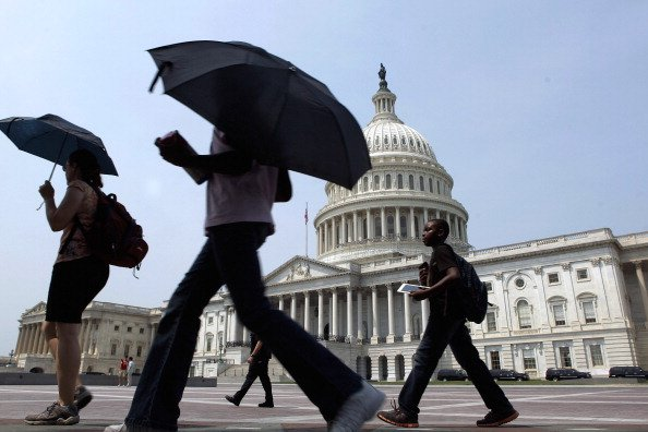 As temperatures top 100-degrees in the nation's capital, tourists take their shade with them by carrying umbrellas as they tour the U.S. Capitol grounds June 29, 2012 in Washington, DC. Heat warnings