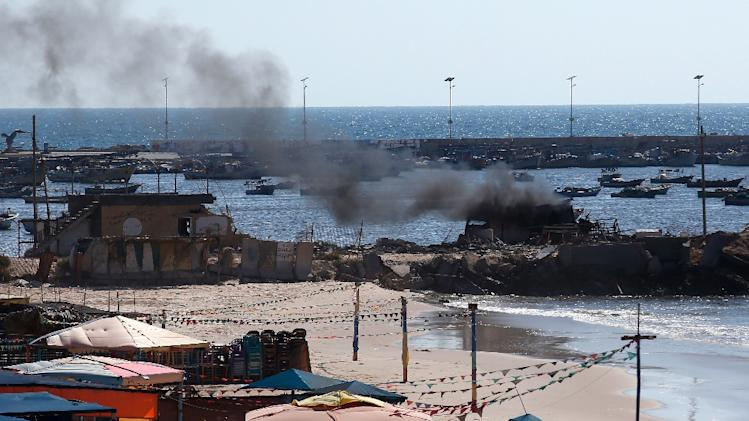 Smoke billows from a beach shack following an Israeli military strike, on July 16, 2014 in Gaza City which killed four children
