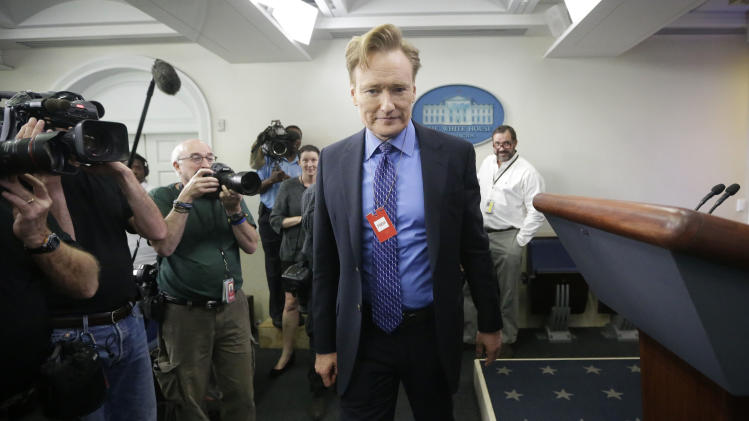 Late-night television host and comedian Conan O'Brien tours the Brady Press Briefing room of the White House in Washington, Friday, April, 26, 2013. O'Brien visited the White House ahead of his schedule hosting of the annual White House Correspondents Dinner on Saturday. (AP Photo/Pablo Martinez Monsivais)
