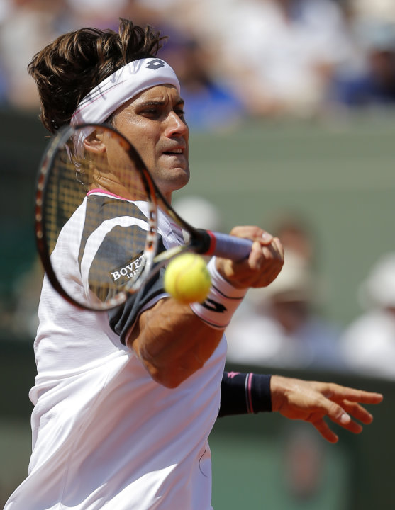 Spain's David Ferrer slams a forehand to Russia's Mikhail Youzhny during their third round match in the French Open tennis tournament at the Roland Garros stadium in Paris, Saturday, June 2, 2012.  (A