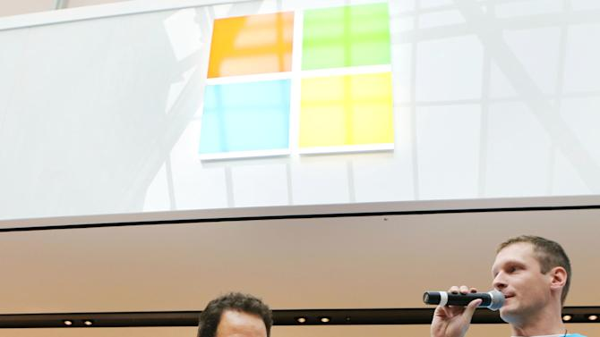 COMMERCIAL IMAGE - In this photograph taken by AP Images for Microsoft, Chris Capossela, Chief Marketing Officer for Microsoft, left, cuts the ribbon, alongside Microsoft Store Manager Ty Hapworth at the grand opening of the Microsoft Store at The Shops at Prudential Center in Boston on Thursday, Aug. 23, 2012. (Bizuayehu Tesfaye/AP Images for Microsoft)
