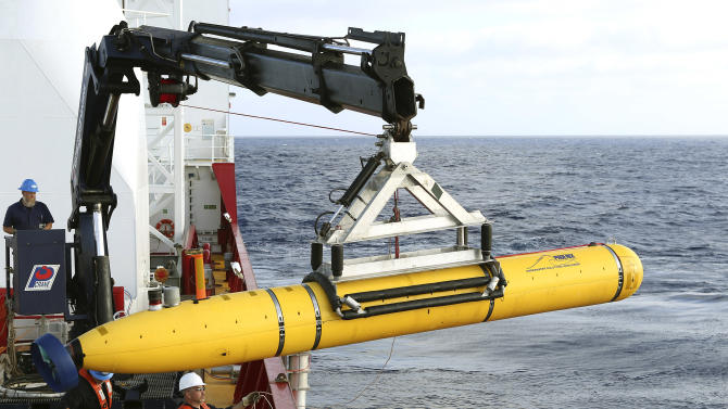 In this Monday, April 14, 2014, photo provided by the Australian Defense Force an autonomous underwater vehicle is prepared to be deployed from ADV Ocean Shield in the search of the missing Malaysia Airlines Flight 370 in the southern Indian Ocean. The search area for the missing Malaysian jet has proved too deep for the robotic submarine which was hauled back to the surface of the Indian Ocean less than half way through its first seabed hunt for wreckage and the all-important black boxes, authorities said on Tuesday. (AP Photo/Australian Defense Force, Lt. Kelli Lunt) EDITORIAL USE ONLY