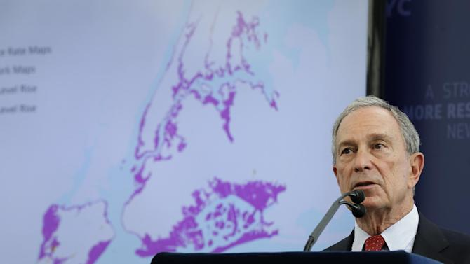 New York City Mayor Michael Bloomberg speaks while a map of the projected 2050s 100-year flood plain of New York City is displayed in New York, Tuesday, June 11, 2013. Removable flood walls would be set up for much of lower Manhattan, a 15-to-20-foot levee would guard part of Staten Island and gates and levees would shield Brooklyn as part of a nearly $20 billion plan Mayor Michael Bloomberg proposed Tuesday to protect New York City from storms and the effects of global warming.   (AP Photo/Seth Wenig)