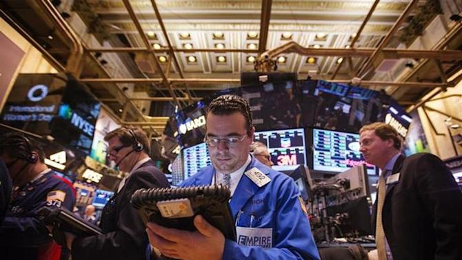Traders work on the floor at the New York Stock Exchange just after the opening bell, March 8, 2013. REUTERS/Lucas Jackson/Files