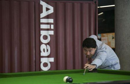 A man plays snooker in a hall inside Alibaba's headquarters in Hangzhou