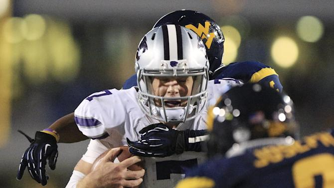 Kansas State quarterback Collin Klein (7) is brought down near the goal line by West Virginia's Pat Miller, rear, and Karl Joseph (8) during the second quarter of an NCAA college football game in Morgantown, W.Va., Saturday, Oct. 20, 2012. Kansas State won 55-14. (AP Photo/Christopher Jackson)