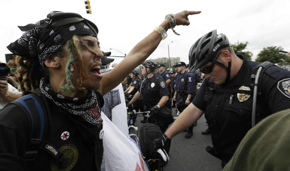 Occupy Demonstrators shout at police during an unscheduled protest march, Tuesday, Sept. 4, 2012, in Charlotte, N.C. The Democratic National Convention begins today. (AP Photo/Patrick Semansky)
