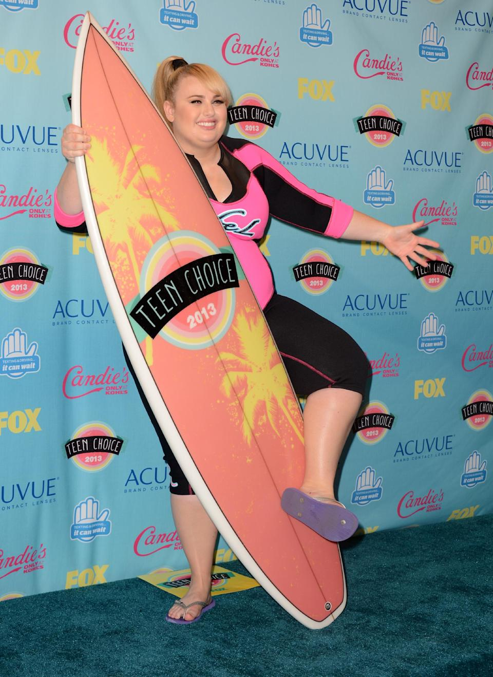 "Rebel Wilson poses backstage with the award for choice movie actress: comedy for ""Pitch Perfect"" at the Teen Choice Awards at the Gibson Amphitheater on Sunday, Aug. 11, 2013, in Los Angeles. (Photo by Jordan Strauss/Invision/AP)"