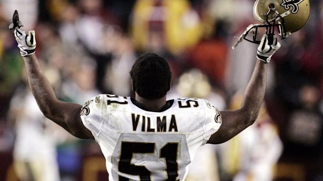 New Orleans Saints linebacker Jonathan Vilma celebrates the Saints overtime win against the Washington Redskins in Landover Maryland