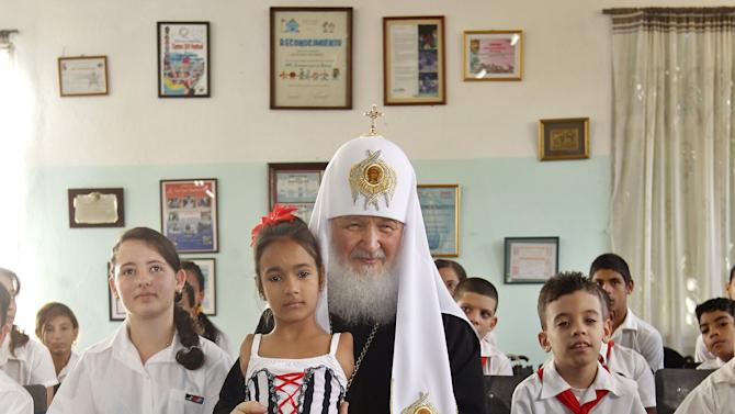 "Patriarch Kirill, the head of the Russian Orthodox Church, poses with children at the special needs school ""Solidaridad con Panama"" (Solidarity with Panama) in Havana"