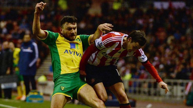 Norwich City's Snodgrass challenges Sunderland's Johnson during English Premier League soccer match at The Stadium of Light in Sunderland