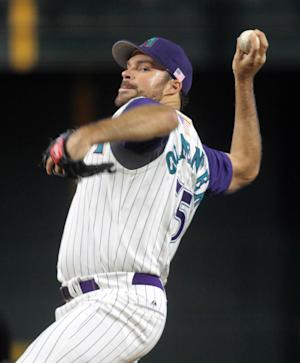 Arizona Diamondbacks pitcher Josh Collmenter throws a pitch to an San Diego Padre during in the second inning of a baseball game Sunday, Sept. 11, 2011, in Phoenix.(AP Photo/Darryl Webb)