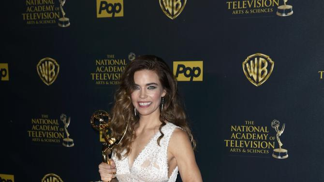"Actress Amelia Heinle poses backstage with her award for Outstanding Supporting Actress in a Drama Series for her role on ""The Young and the Restless"" at the 42nd Annual Daytime Emmy Awards in Burbank"