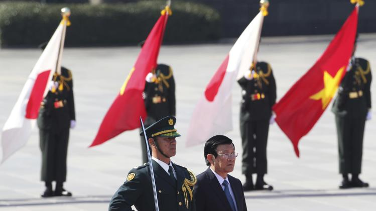 Vietnam's President Truong Tan Sang attends a welcoming ceremony at the Imperial Palace in Tokyo