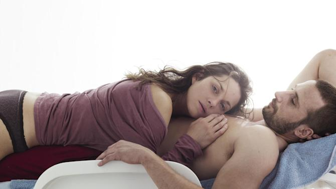 """This film image released by Sony Pictures Classics shows Marion Cotillard, left, and Matthias Schoenaerts  in a scene from """"Rust and Bone."""" The film was nominated for a Golden Globe for best foreign film on Thursday, Dec. 13, 2012. (AP Photo/Sony Pictures Classics)"""
