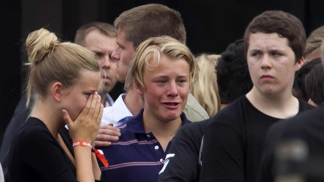 Unidentified survivers from the shooting at an island youth retreat react outside a hotel where survivors were being reunited with their families in Sundvolden, Norway, Saturday, July 23, 2011. The 32-year-old man suspected in bomb and shooting attacks that killed at least 91 people in Norway bought six tons of fertilizer before the massacres, the supplier said Saturday as police investigated witness accounts of a second shooter.  Norway's prime minister and royal family visited grieving relatives of the scores of youth gunned down in a horrific killing spree on an idyllic island retreat. .  (AP Photo/Matt Dunham)
